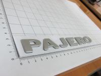 Эмблема шильдик Pajero для Mitsubishi на багажник 205*23 мм