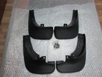 Оригинальные брызговики на Mazda 2003