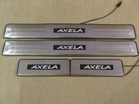 Светодиодные накладки на пороги Mazda Axela 2009-2014